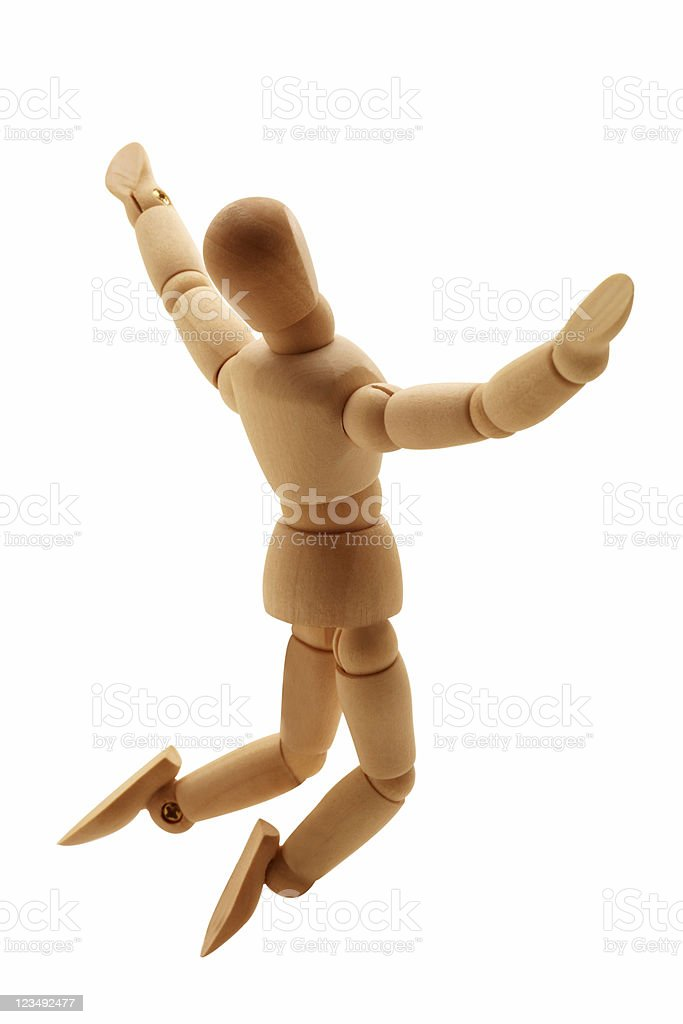 wooden man leaping in the air royalty-free stock photo