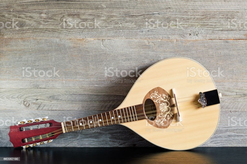 Wooden Mandolin on a Black Table stock photo