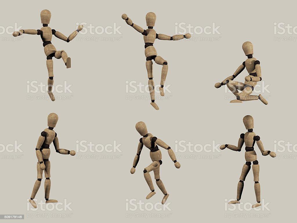 wooden manikin in various poses stock photo