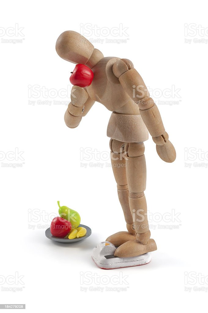 Wooden mannequin and bathroom scales stock photo