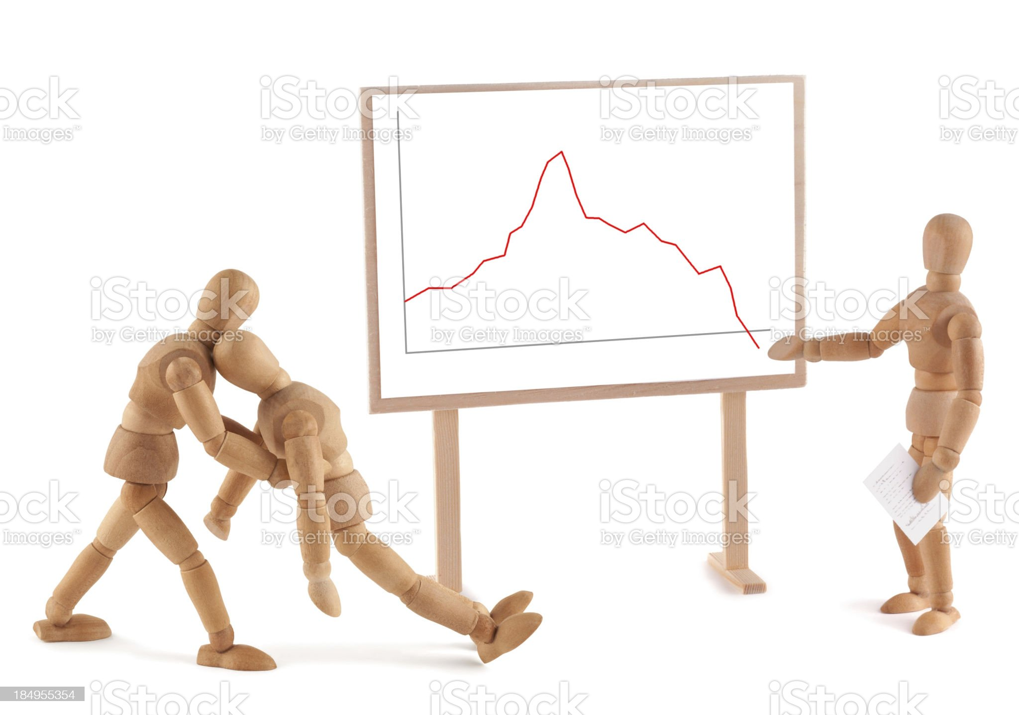 Wooden Mannequin and business graph royalty-free stock photo