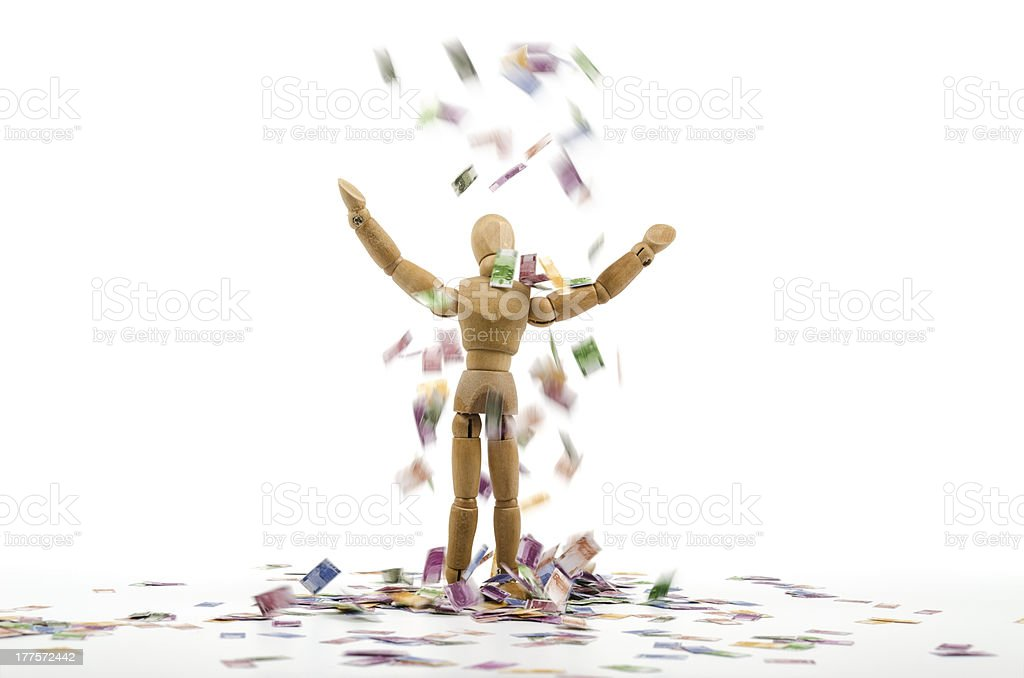 Wooden mannequin and falling euro money stock photo