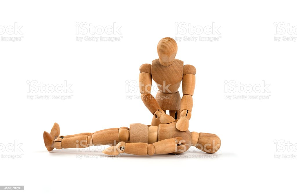 wooden mannequin and first aid with reactivation stock photo