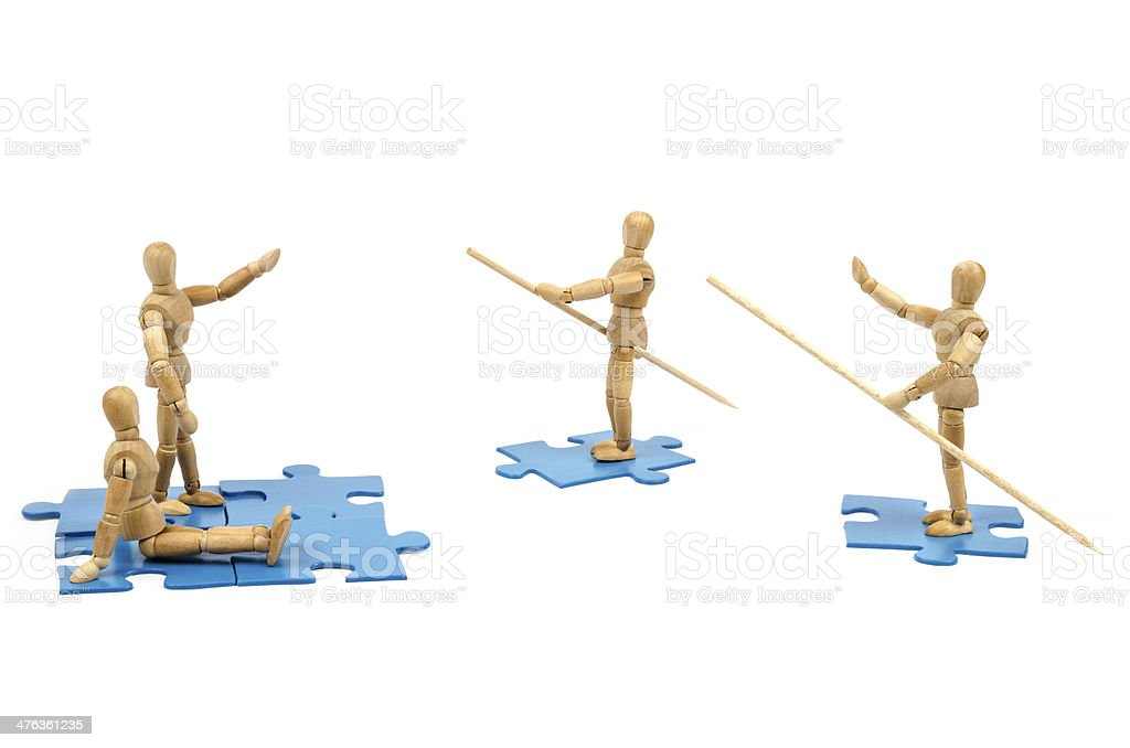 Wooden Mannequin and new solution at jigsaws royalty-free stock photo