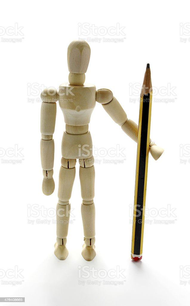 Wooden mannequin and pencil stock photo