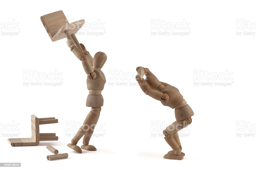 Wooden mannequin and violence stock photo