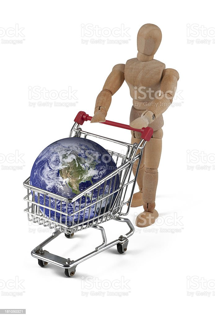 wooden mannequin buying earth stock photo