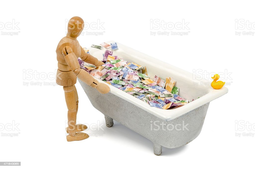 Wooden  mannequin can bath in Euro notes royalty-free stock photo