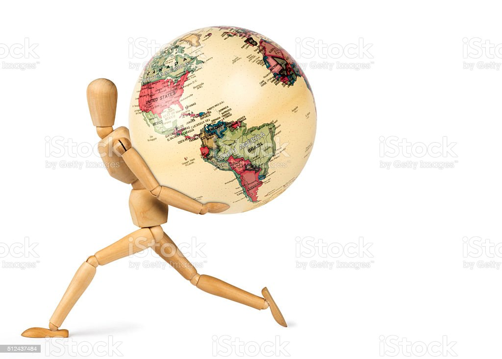 Wooden mannequin carrying a wooden globe on his back stock photo