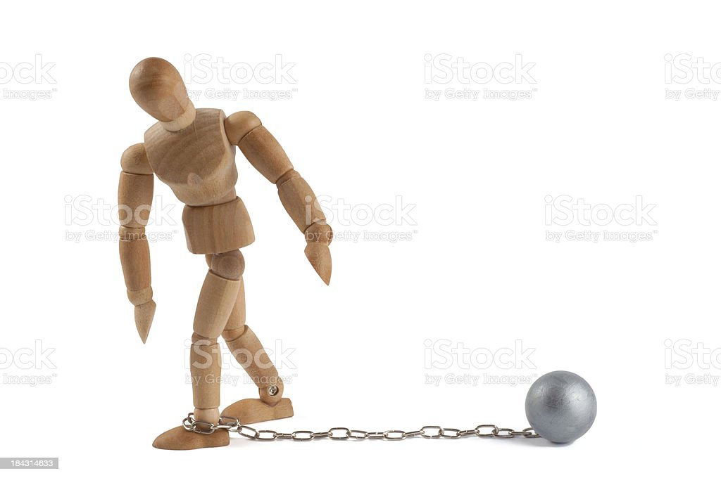 Wooden mannequin chairbounded on an iron ball stock photo