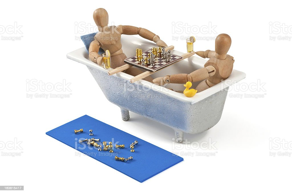 wooden mannequin chess match in bathtub royalty-free stock photo