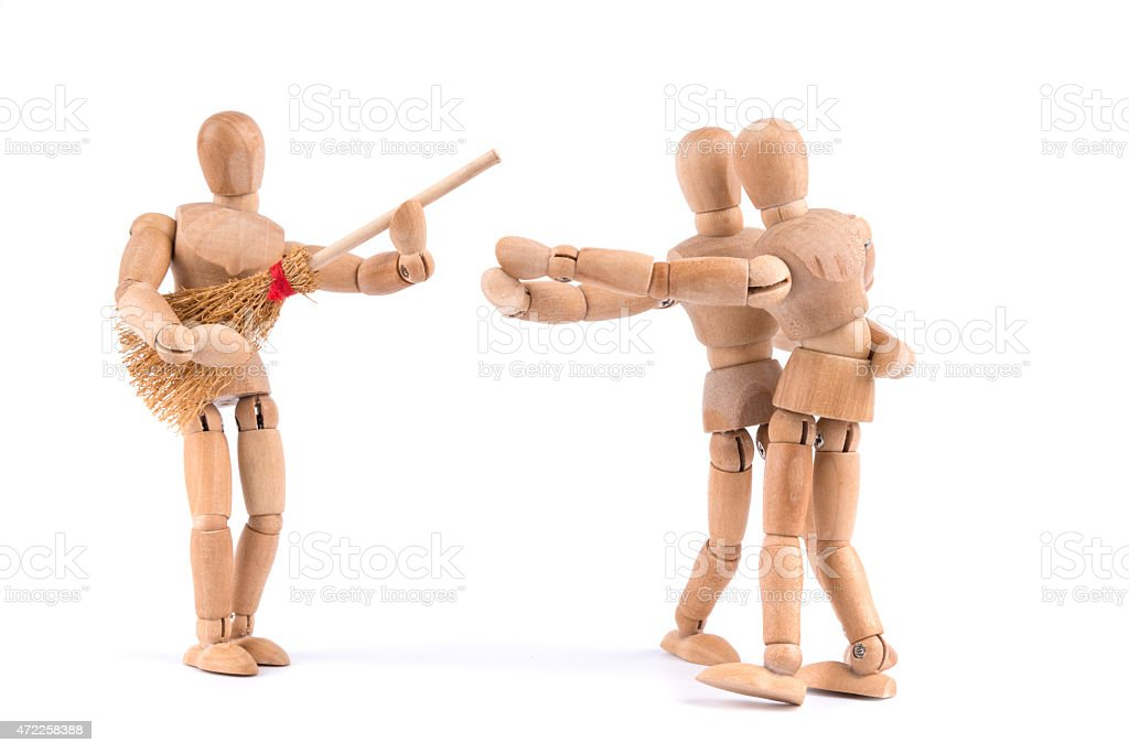 wooden mannequin couple dancing to air guitar music- love fun stock photo
