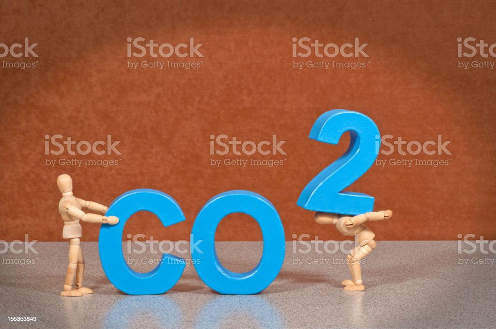 CO2- Wooden Mannequin demonstrating this word stock photo