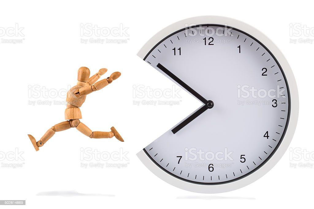 wooden mannequin escaping from snapping clock stock photo