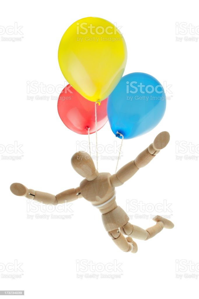 wooden mannequin flying with ballons stock photo