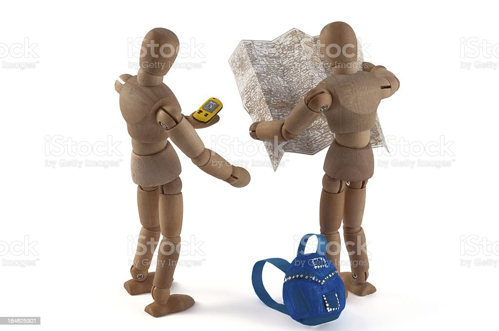 Wooden mannequin geocaching or hiking with map stock photo