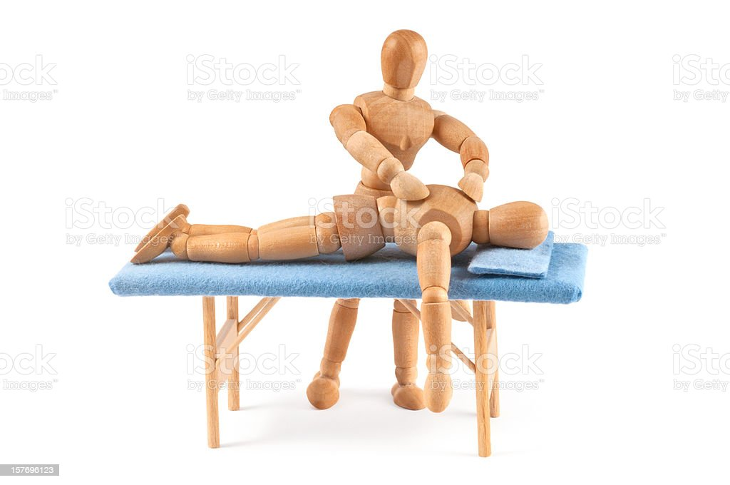 wooden mannequin gives a massage - relaxing time royalty-free stock photo