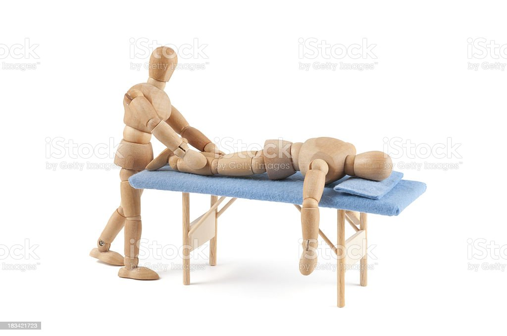 wooden mannequin gives a massage - relaxing time stock photo