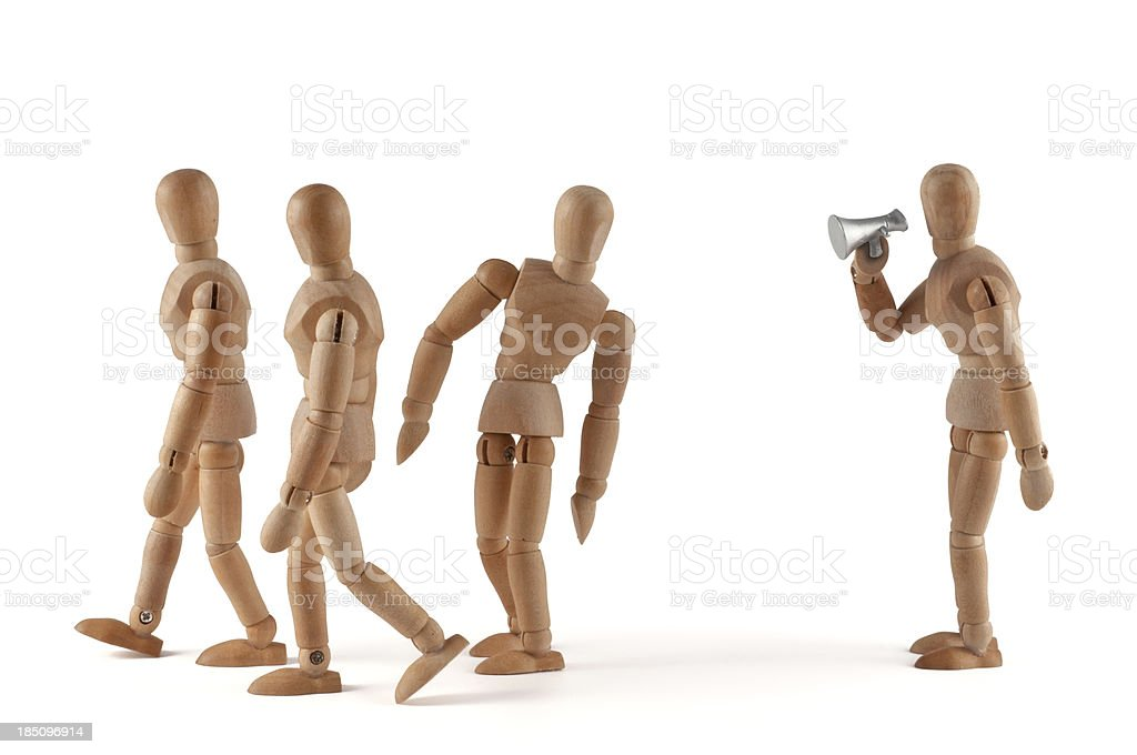 Wooden mannequin hearing news (or not) royalty-free stock photo