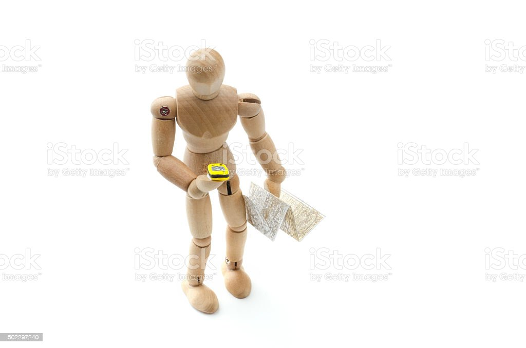 wooden mannequin hiking with GPS and map stock photo