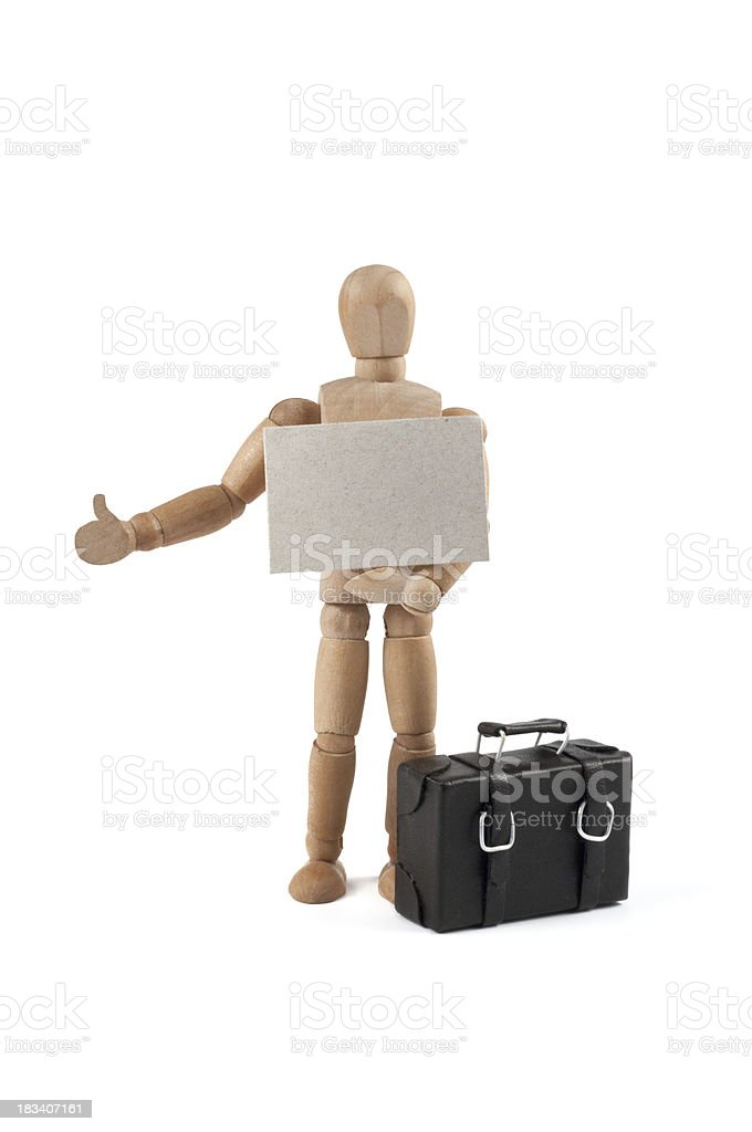 wooden mannequin hitchhiker with sign stock photo