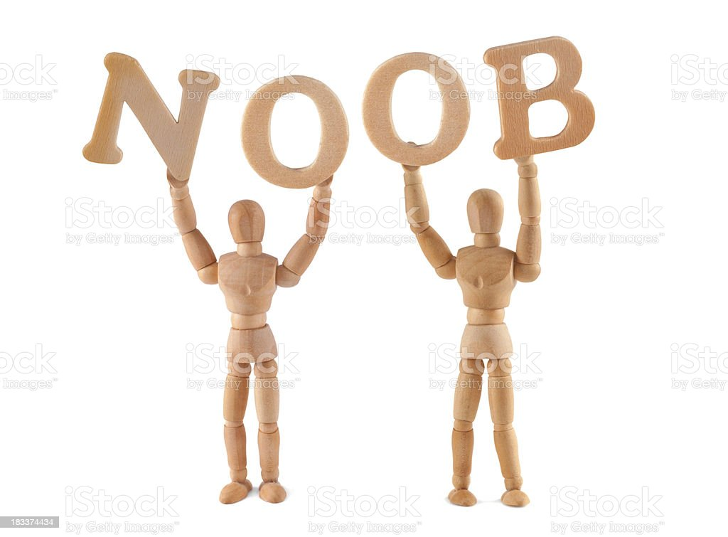 NOOB - wooden mannequin holding this word royalty-free stock photo