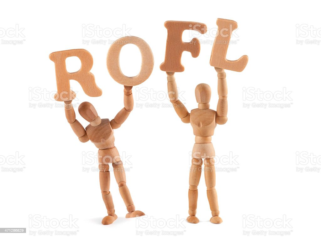 ROFL - wooden mannequin holding this word royalty-free stock photo