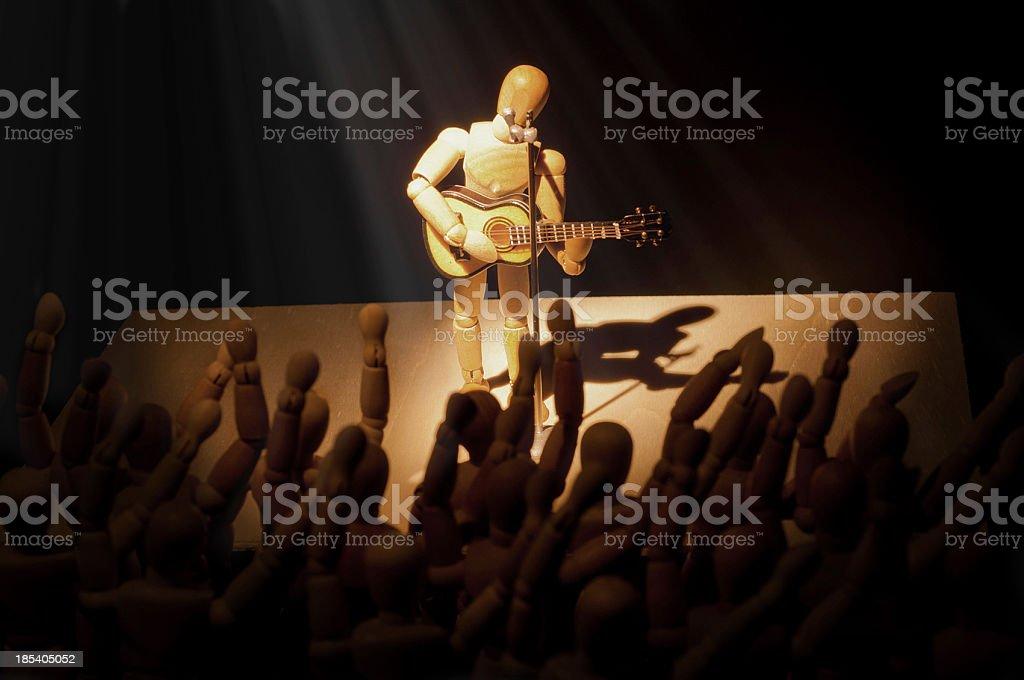 wooden mannequin in concert stock photo