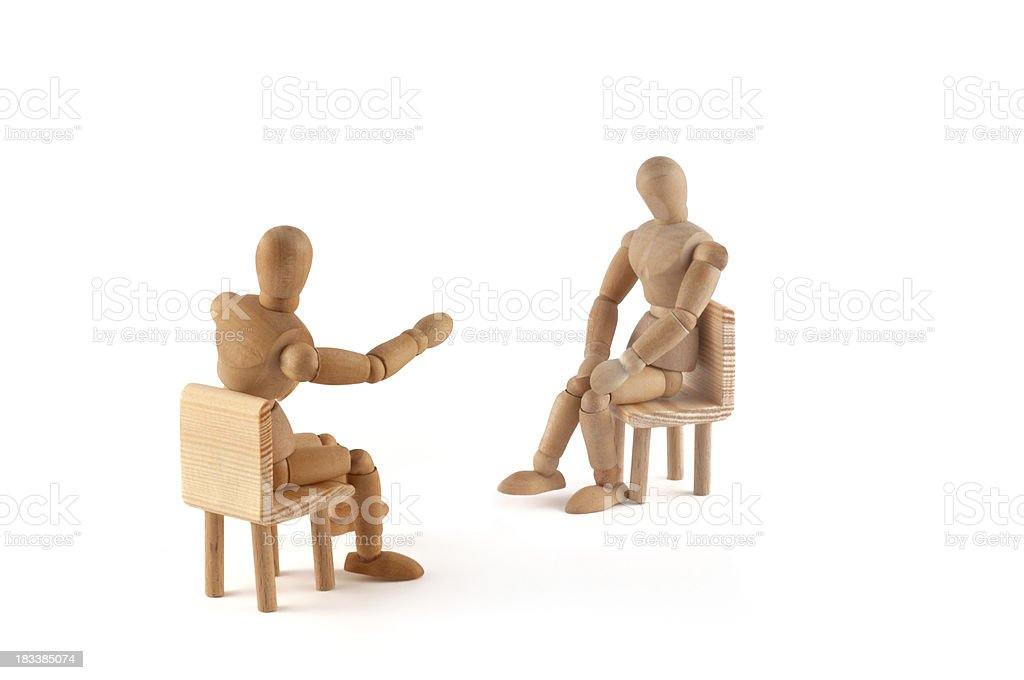 wooden mannequin in discussion stock photo