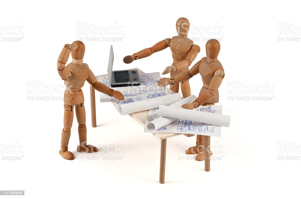 wooden mannequin in discussion with engeneering department stock photo