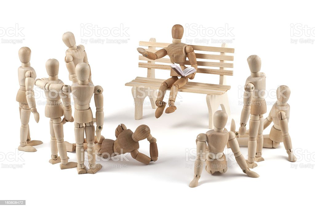 wooden mannequin listening to a story teller stock photo