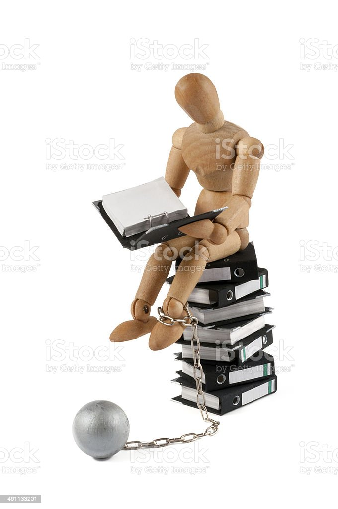 wooden mannequin on folder stack with iron ball stock photo
