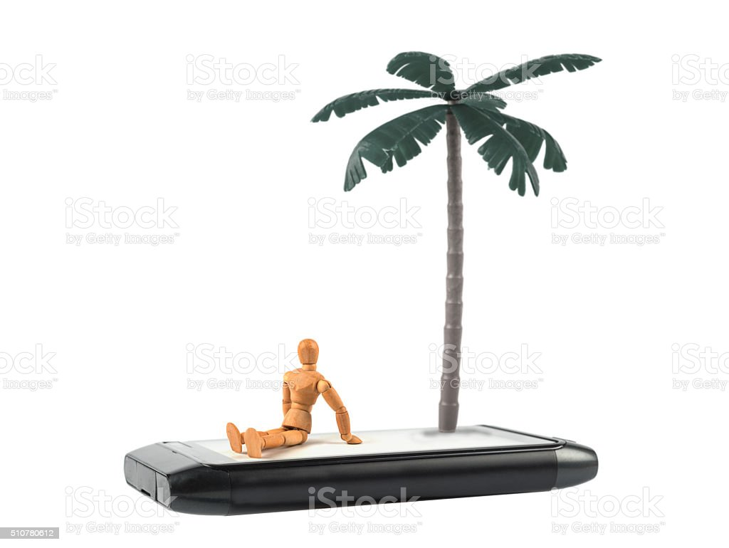 wooden mannequin on lonely island on a smartphone stock photo