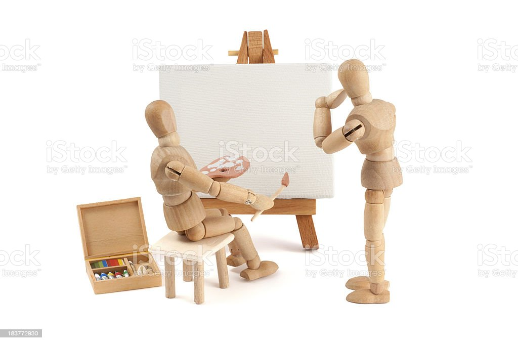 wooden mannequin painting in oil - copy space stock photo