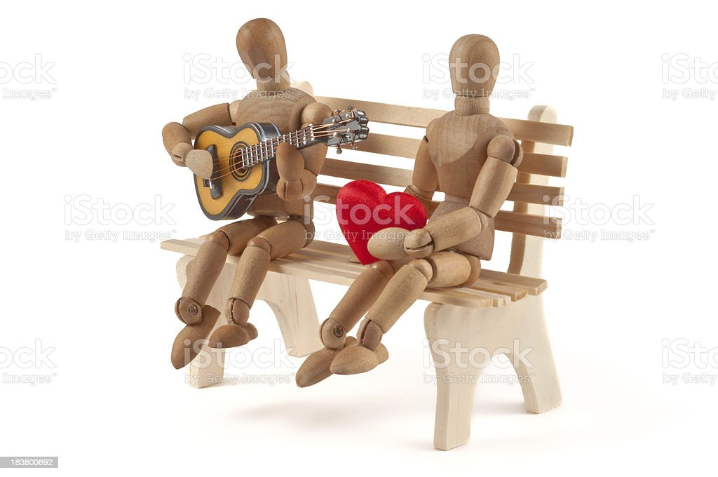 wooden mannequin plays guitar for his girlfriend stock photo
