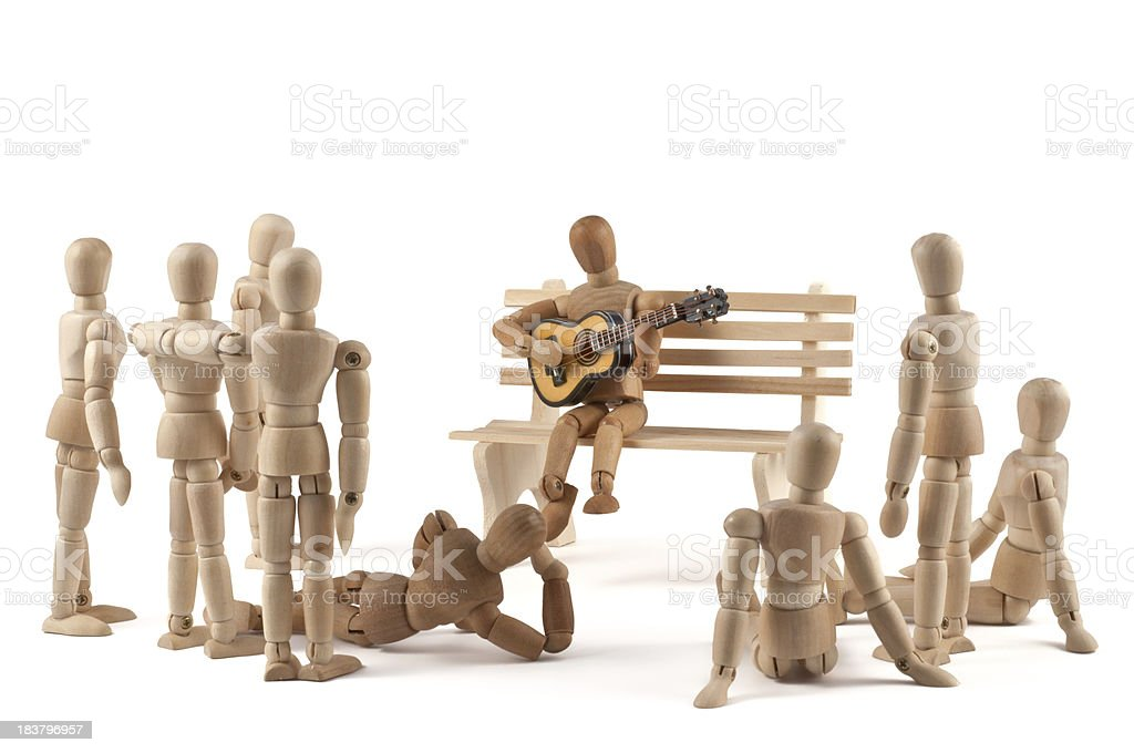 wooden mannequin plays guitar for listener stock photo