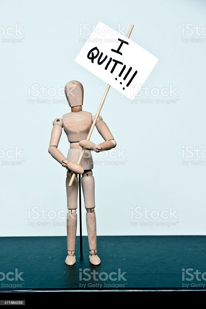 wooden mannequin: protester 'I quit' stock photo