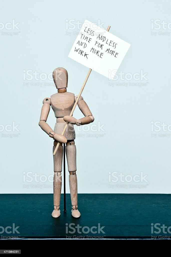 wooden mannequin: protester 'less time for more work' stock photo