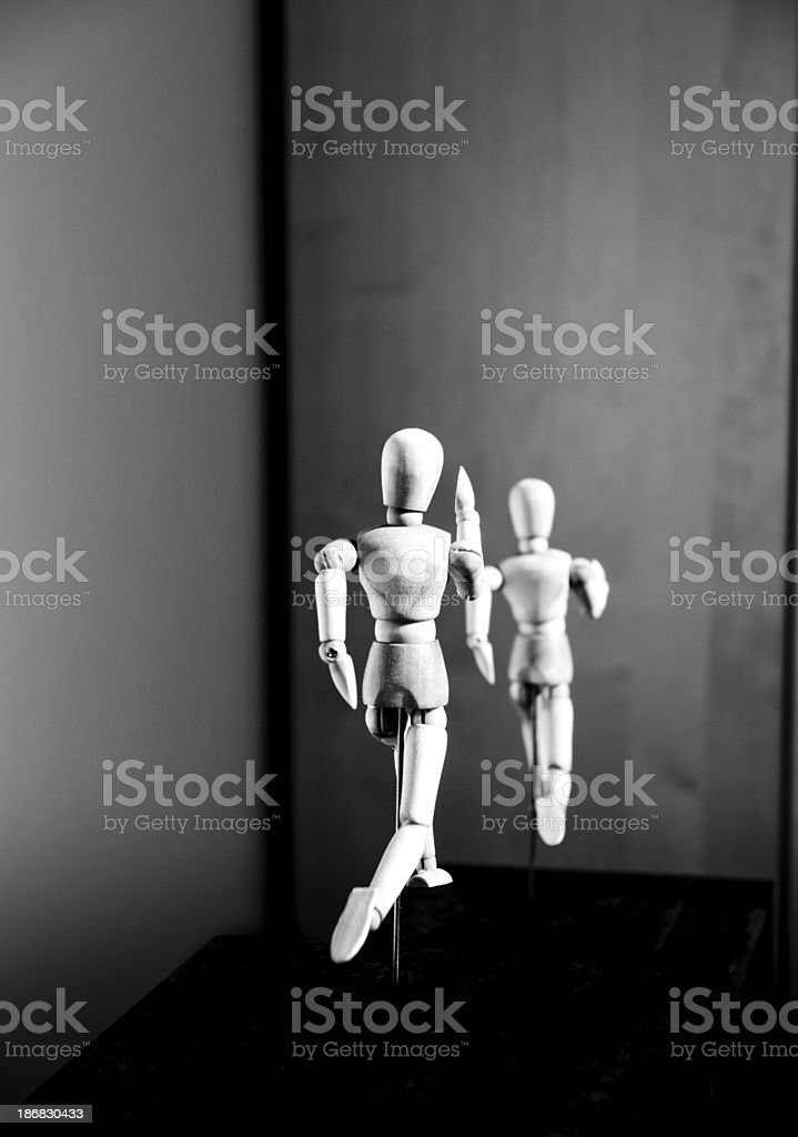 Wooden Mannequin: race down a hill royalty-free stock photo