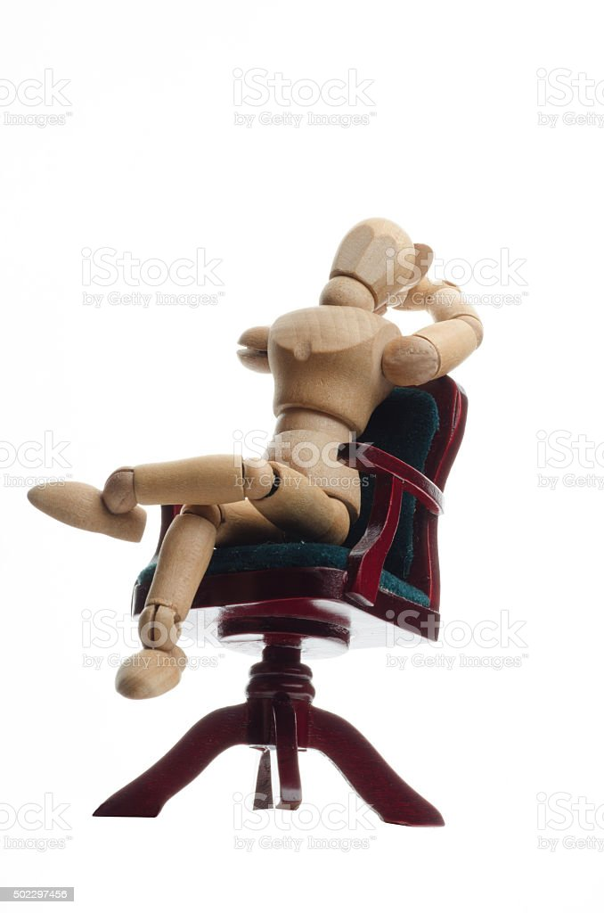 wooden mannequin relaxing on seat and looking in sky stock photo