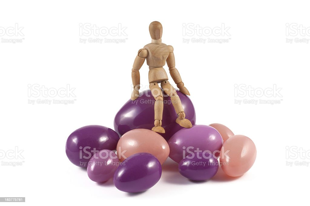 wooden mannequin resting on easter eggs royalty-free stock photo