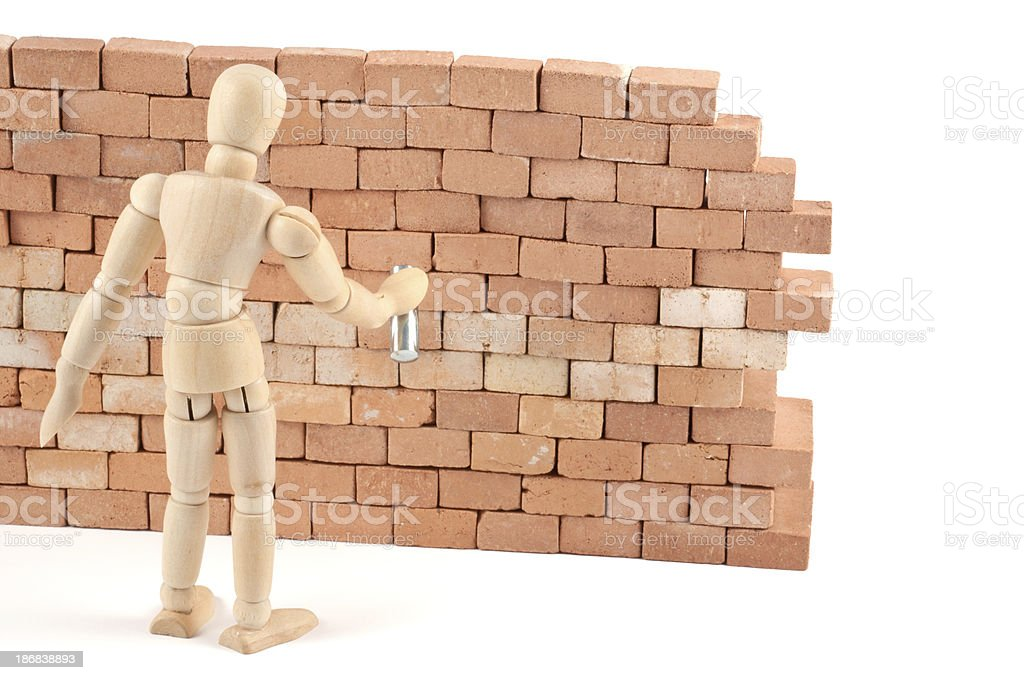 wooden mannequin spraying something on a wall - wand picture stock photo
