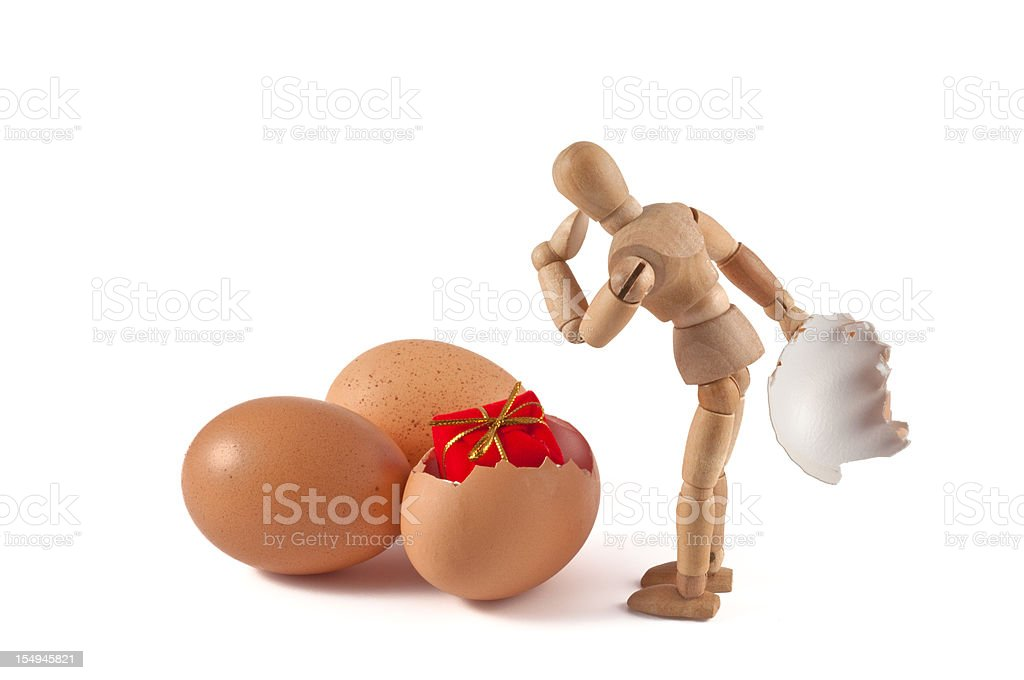wooden mannequin surprised of an easter egg royalty-free stock photo