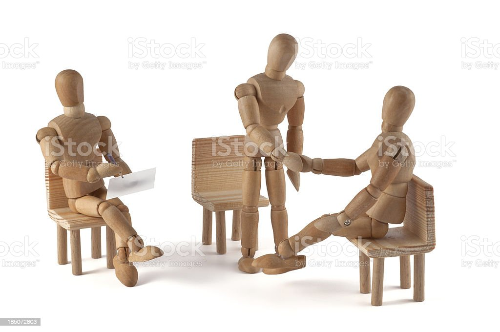 wooden mannequin talking - hand shaking stock photo