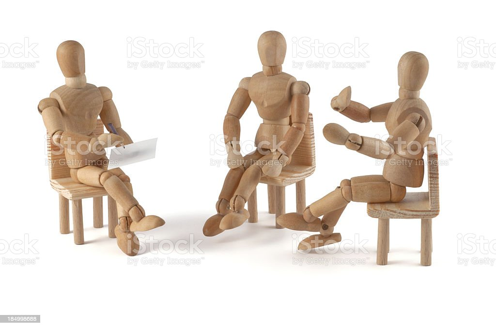 wooden mannequin talking stock photo