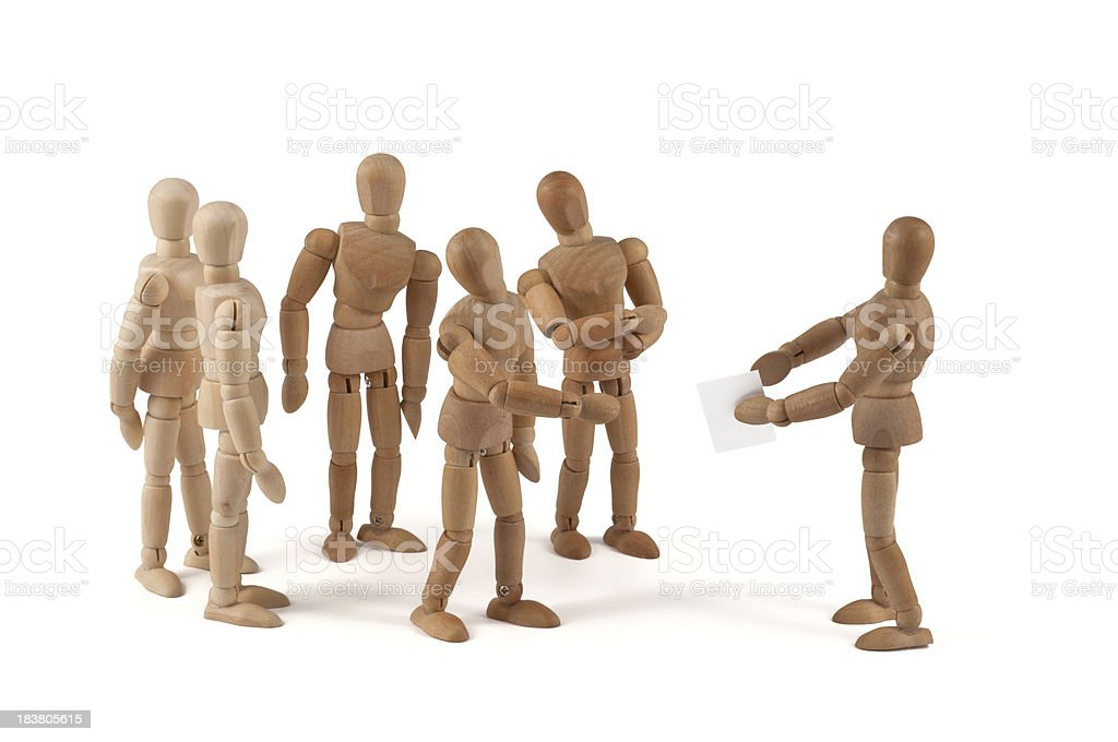 wooden mannequin team in discussion stock photo