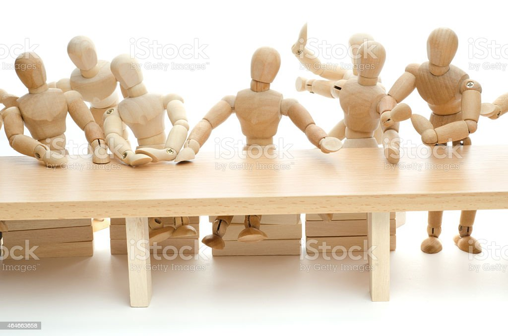 wooden mannequin together in team discussion stock photo
