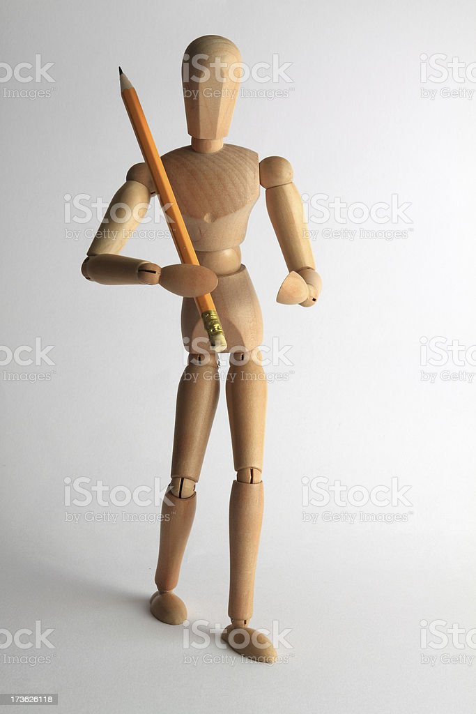 Wooden mannequin with pencil royalty-free stock photo