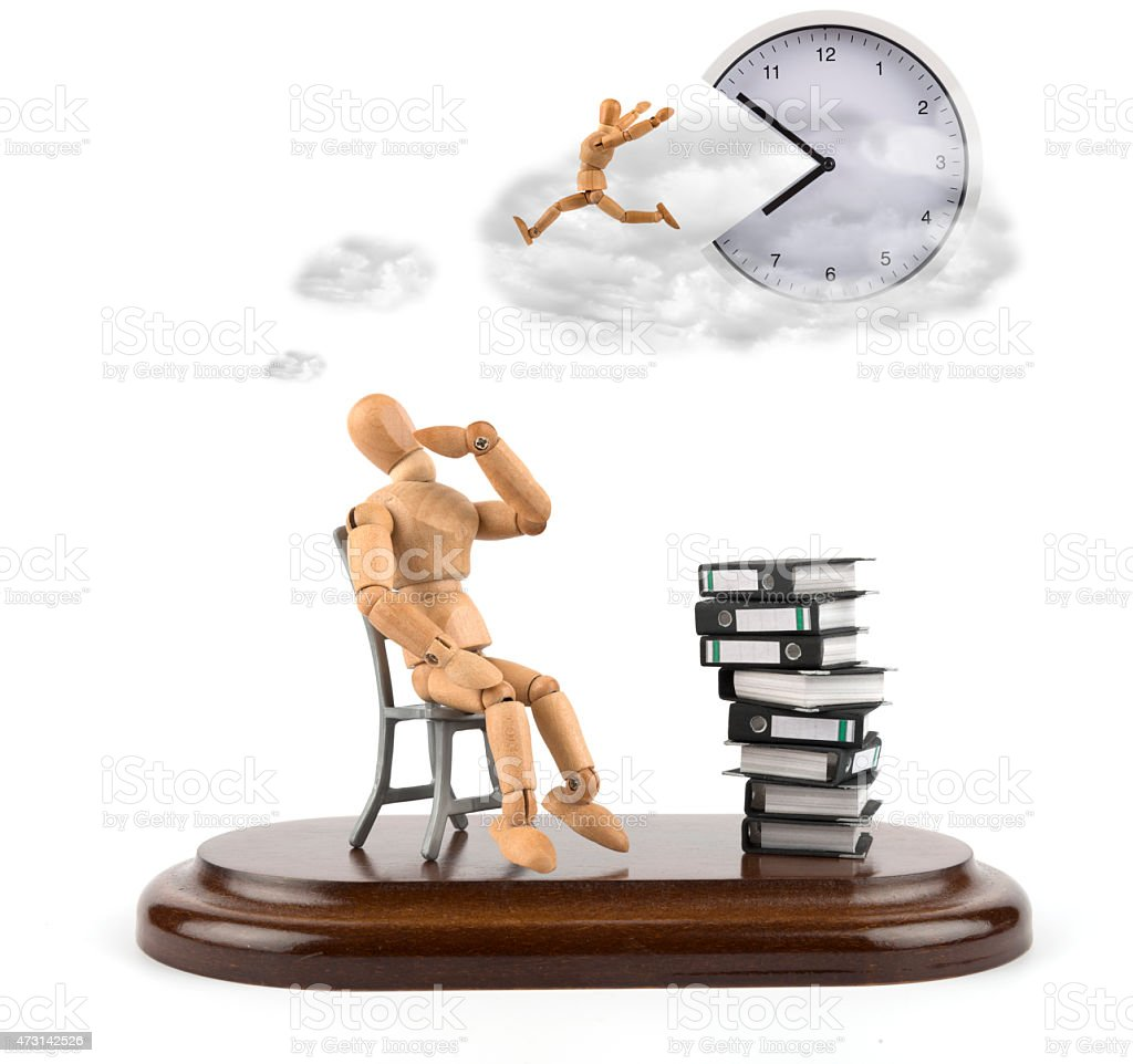 wooden mannequin with ring binders thinking about rest of time stock photo