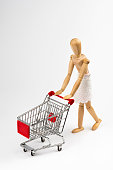 Wooden Mannequin with Shopping Cart